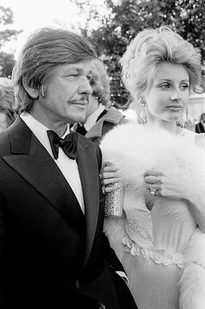 "Charles Bronson & Jill Ireland, when Charles Bronson saw Jill Ireland for the first time she was married to David McCallum, attending the same party, and Charles was in a Tux....he took one look at Jill & told David ""within a year I will have your wife""...true story, and he did. They were not intimate until she was divorced from David"