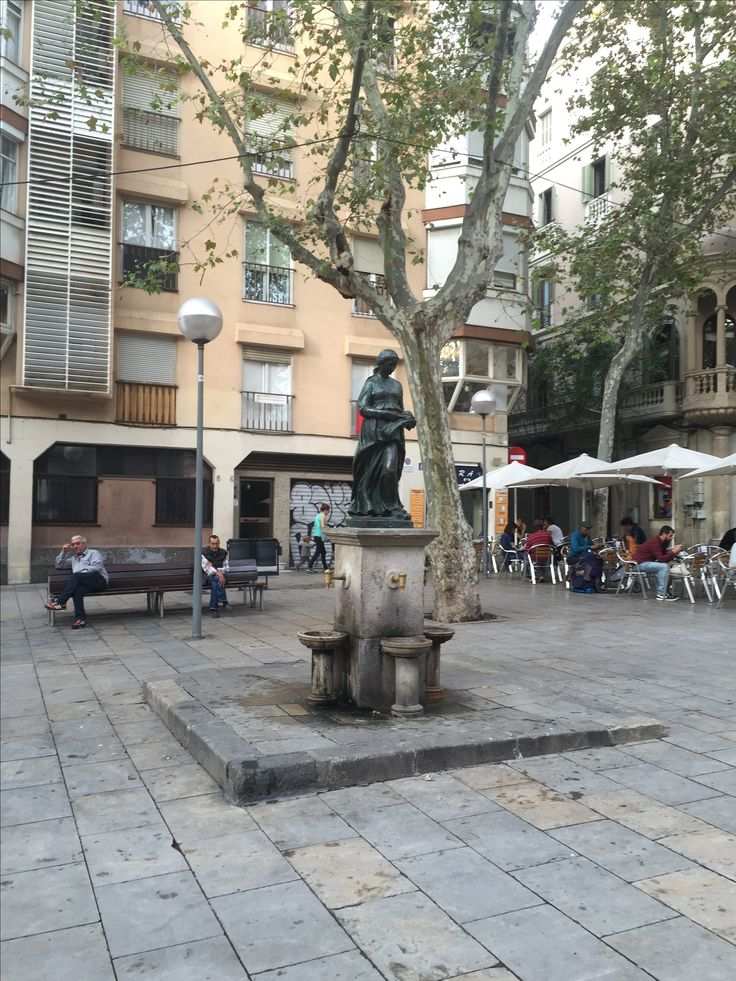 This picture was taken in the Gràcia neighborhood, in Plaça de la Virreina. This statue is of Ruth of the Old Testament. She is carrying wheat after learning about the death of her husband. It is an ode to the story of La Virrenia, who was widowed at a young age. La Virrenia, like Ruth, spent their life doing good deeds in the name and sake of their husbands.