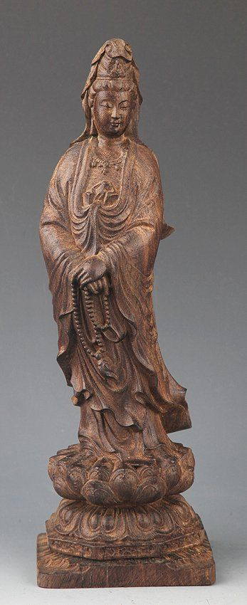 A FINELY CARVED AGAR WOOD GUANYIN : Lot 109