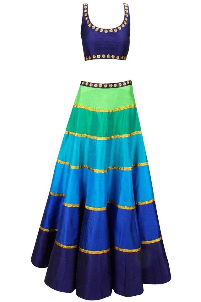 This lehenga set features a blue raw silk blouse with gold sequins floral motifs on neckline and hem along with shades of blue and green raw silk lehenga in striped pattern with gota lines and can-can