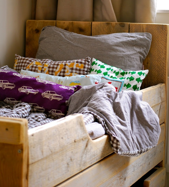 love the rustic, handmade coziness off this wood bed and layers of bedding
