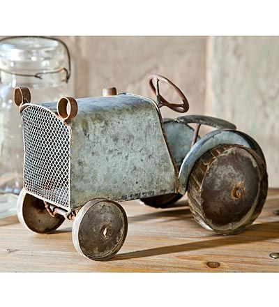 Metal Tractor...to love forever....child to man