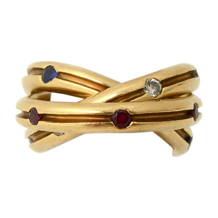 CARTIER  Rolling Ring with Diamonds, Rubies and Sapphires   From a unique collection of vintage fashion rings at https://www.1stdibs.com/jewelry/rings/fashion-rings/