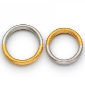 Niessing Symbolon. »Jeder trägt mit seinem Ring ein Teil des anderen bei sich. Der Ring als Symbol für eine leidenschaftlich geschlossene Ve...