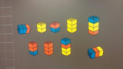 Rakennetaan kirjan 1a s.49 mukaiset tornit. Taululla on samat tornit eri järjestyksessä. Oppilaita pyydetään sanallisesti korjaamaan taulu samanlaiseksi kuin kirjassa. Tehdään erotteluperusteita ja ryhmitellään tietyn ominaisuuden mukaan.
