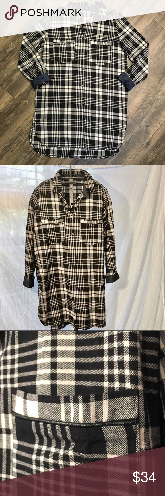 Black and white plaid flannel shirt dress Aborable T-shirt dress with 3/4 length sleeves. End of sleeves are lined in denim. Leather piping detail on pockets on chest. Front button closure.  90% cotton  35 in length Fate Dresses