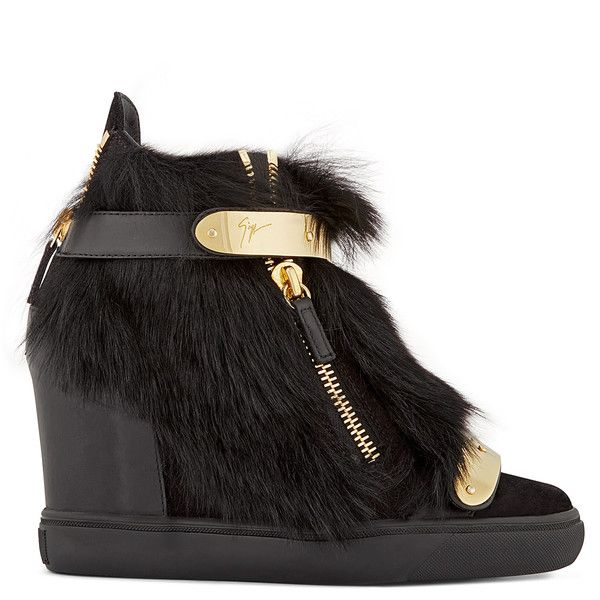 Tufts of shearling and slicks of golden metal trim these high-top sneakers, giving them a uniquely stylish appearance. Containing a concealed wedge, they're an