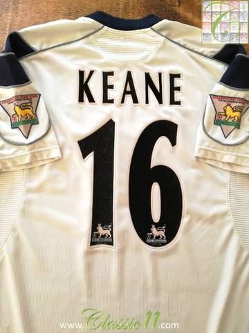 Official Umbro Manchester United away football shirt from the 2000/01 season. Complete with Keane #16 on the back of the shirt and Premier League champions patches on the sleeves.
