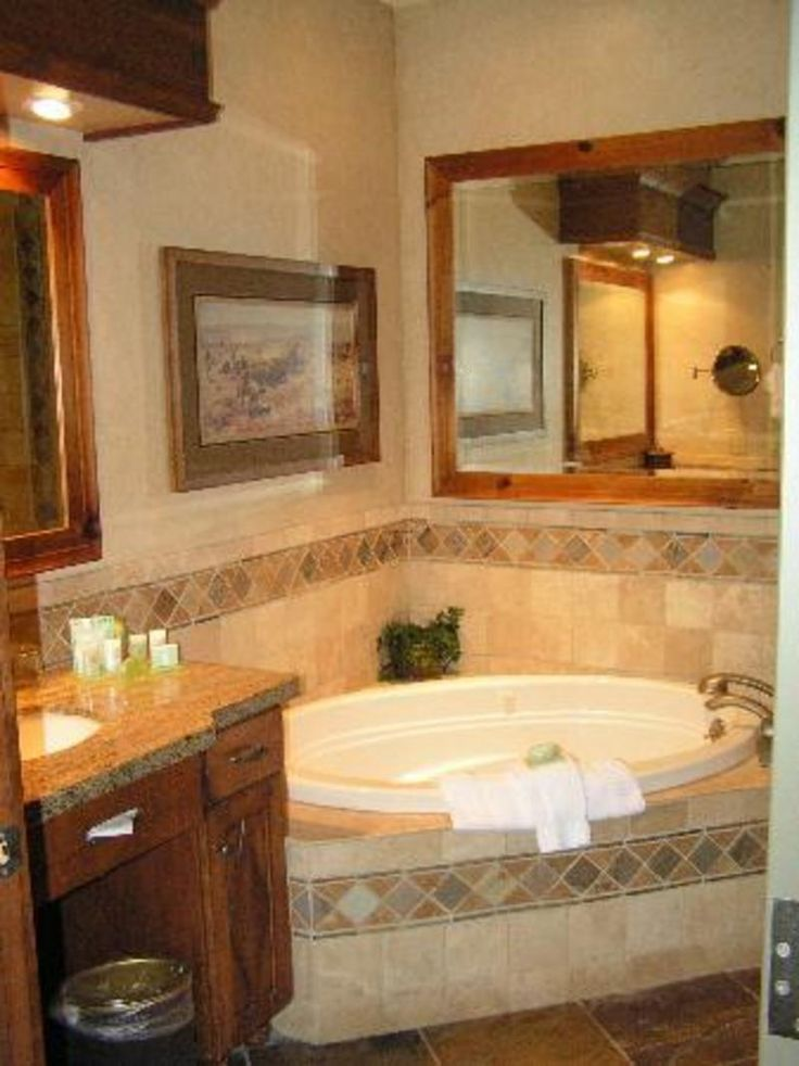 corner soaking tub with surround tile. same layout as our bathroom but updated/better tub