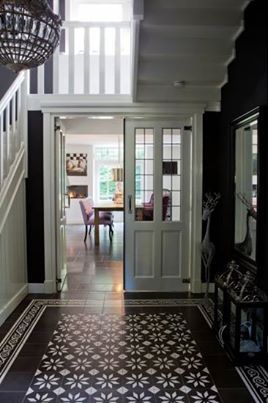 This floor is a must! But the rest of the walls didn't have to follow the same black pattern.