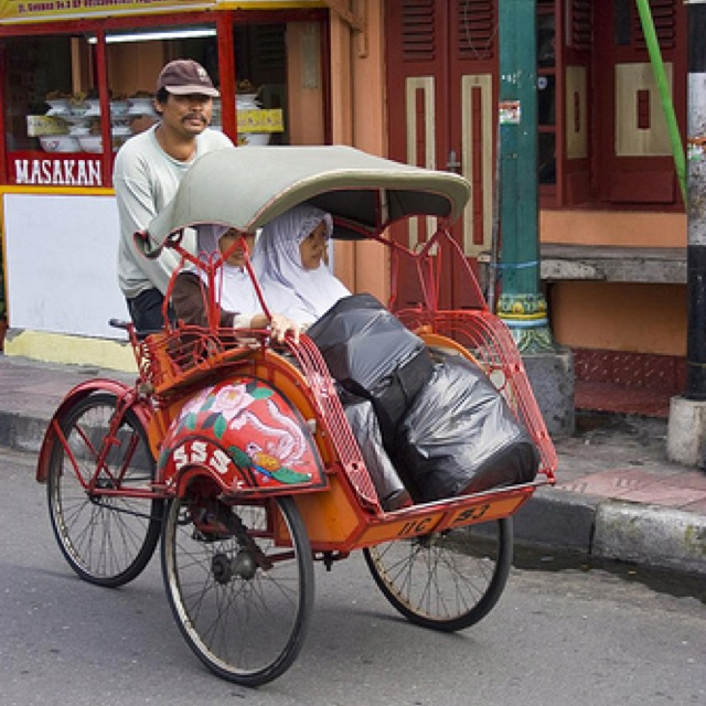 Becak - one of cheapest way to get around town! :)