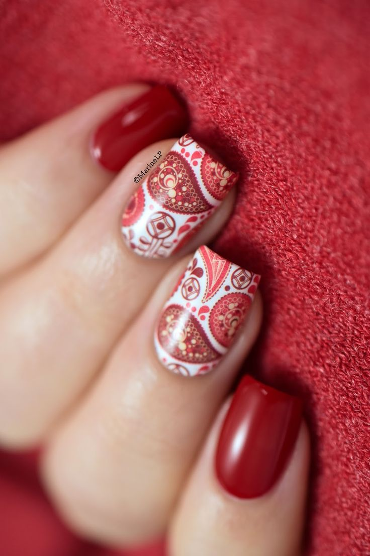 Red paisley water decals nail art.
