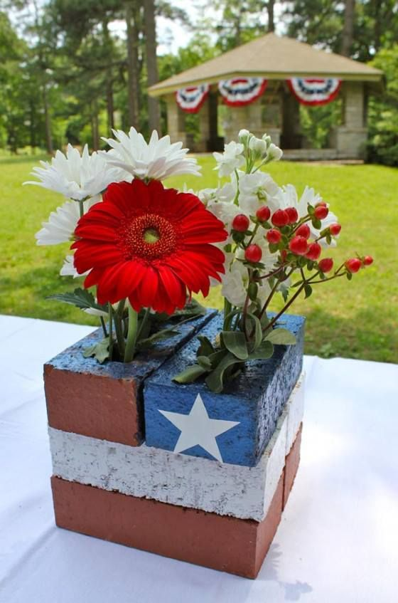 Simple centerpiece or front porch idea! Paint some bricks and stick some Red, White, & Blue flowers in.                                                                                                                                                     More