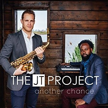 The JT Project: a multi-talented force of sound that brings forth a unique musical conceptualization: 'a new genre in music called JT'. Adventurous and bold Jacob Webb (Keyboards/Bass) and Todd Schefflin (Saxophone) leaders of The JT Project knew that it would take more than just a passing interest in music to become the creative force that they envisioned. Jacob commands each stroke on the keyboard to awaken the soul with a touch of fire and Todd caresses the notes to life with every…