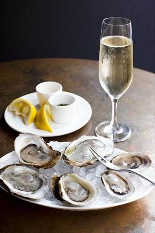 """John Dory Oyster Bar - they have a """"daytime cocktail"""" *** this was the backdrop to one of the most romantic day-dates of my life...also good for flying solo day or night"""