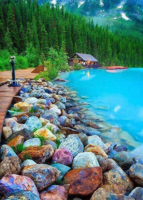 Colorful rock shore of Lake Louise, Canada