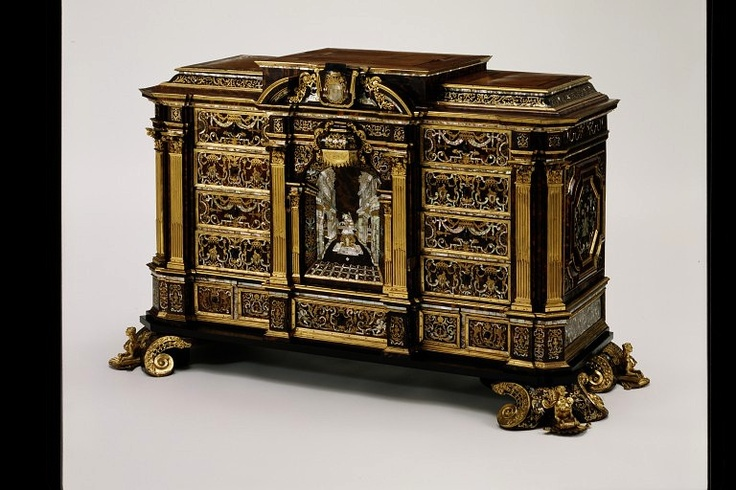 LavishShoestring.com |  Table cabinet        Place of origin:        Vienna, Austria (possibly, made)      Augsburg, Germany (possibly, made)      Date:        1715 (made)      ca. 1735 (altered)      Artist/Maker:        Unknown (production)      Materials and Techniques:        Marquetry of tortoiseshell, mother-of-pearl, brass and copper, on an oak carcase, with gilt-copper mounts and drawers lined with printed paper; the top of the cabinet is veneered in walnut and mahogany