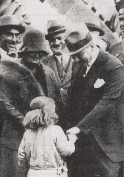 Ataturk loving a child with Afet İnan, Dortyol trip, Feb.15, 1931
