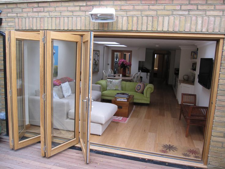 wrap around rear and side extension to a 2 bed flat in Wimbledon. We dont use timber sliding/ folding doors often enough