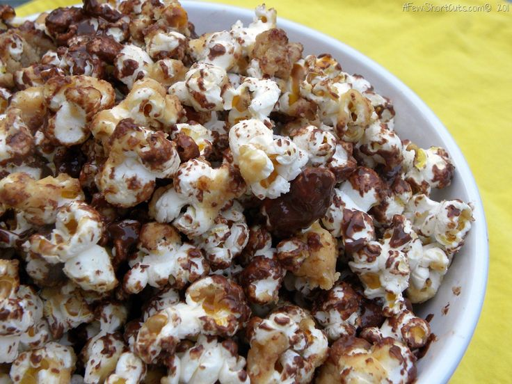 Chocolate Peanutbutter Popcorn... Shut the front door... that has all the ingredients of happiness!