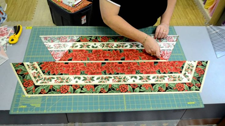 uses a yard and a half of fabric and gets two table toppers, two large table toppers, two smaller table toppers and some mug rugs. Utilizes yardage with no scrap, terrific!