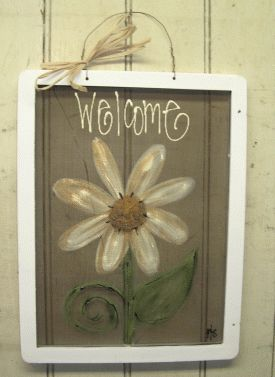 Paint an old widow screen for a new twist on a Welcome sign.