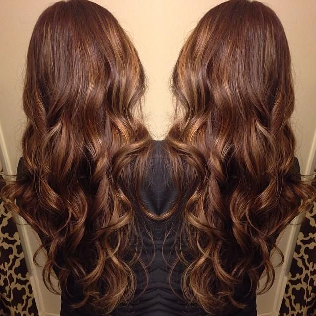 From a dark box brown color, lifted her base to a nice medium brown and added balayage highlights to brighten up her brown.