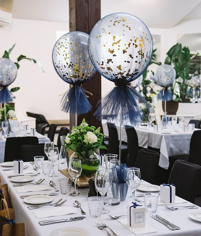 Close up of our navy and gold tulle balloons                                                                                                                                                                                 More