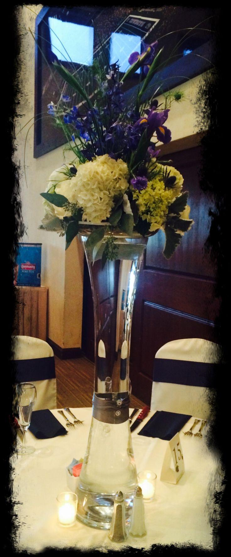 White hydrangea blue delphinium and purple iris wedding