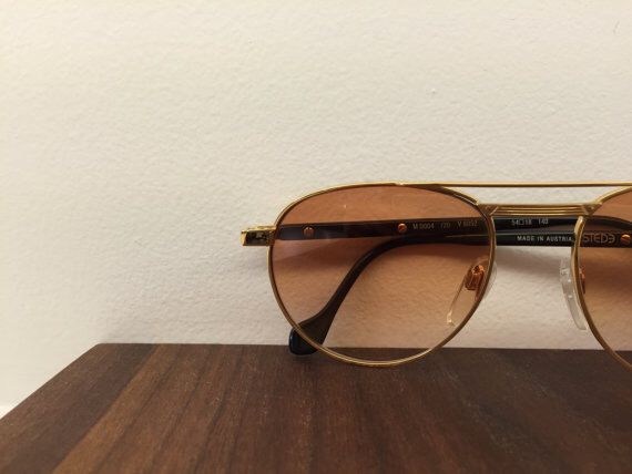 1980's MAN vintage gold sunglasses by Estede // Dupont by blackandbluevintage on Etsy https://www.etsy.com/listing/218930951/1980s-man-vintage-gold-sunglasses-by