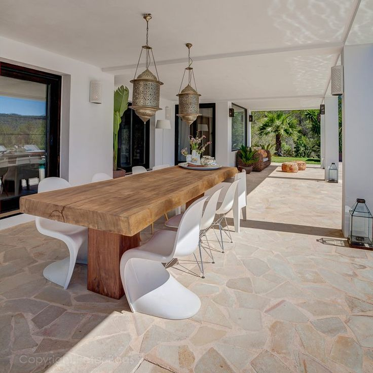 chairs contrasting with tables, lanterns, stone floors