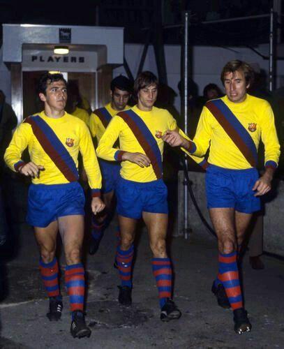 Johan Cruyff leads Barcelona out in 1977.