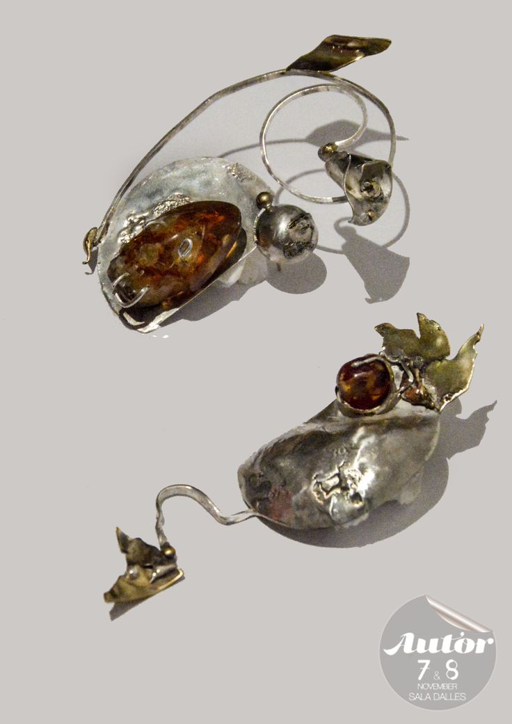 Pair of asimetric  earrings made of Silver.Large Amber stone with a carved in skull. - By Cubici Corina - Florina