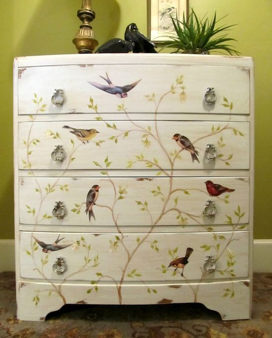 """The body of the chest was painted Cloudy Morning  The branches were painted with acrylic craft paint. vintage bird graphics printed them on card stock and used Mod Podge to decoupage them onto the front of the chest."""
