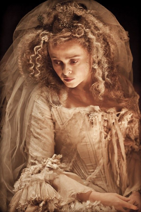 "Helena Bonham Carter as Miss Havisham from ""Great Expectations.""  How perfect would a tattered & torn wedding dress on a haunted bride costume be?  Hey, why not serve wedding cake on the buffet table? Halloween Horrors in Victorian London Party Decorating & Ideas"