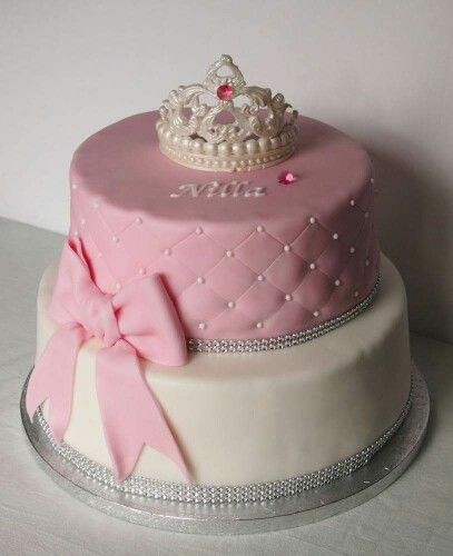 Christeningcake with a tiara and a huge bowtie