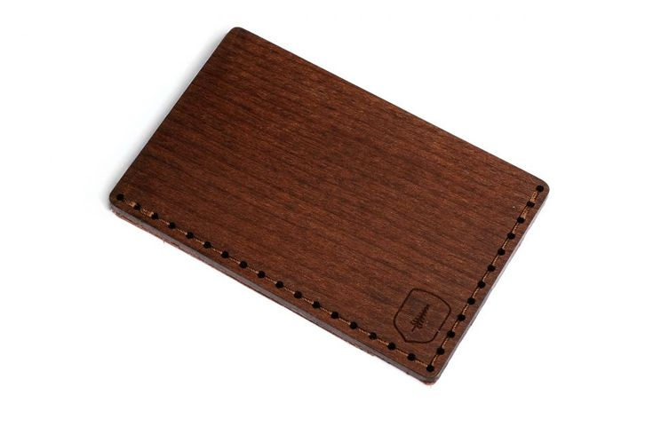 The Brunn Note wooden card holder combines craftsmanship, style and functionality. Made out of natural beech and stained to the darker color to give it an elegant touch, it was later paired with genuine leather. This masculine, ecological and stylish wooden accessory comes in handy the next time you want to leave your wallet at home. Get all your business cards in one place – there is enough space for up to 25 of them or choose to use it as your credit card holder with up to 7 of them…