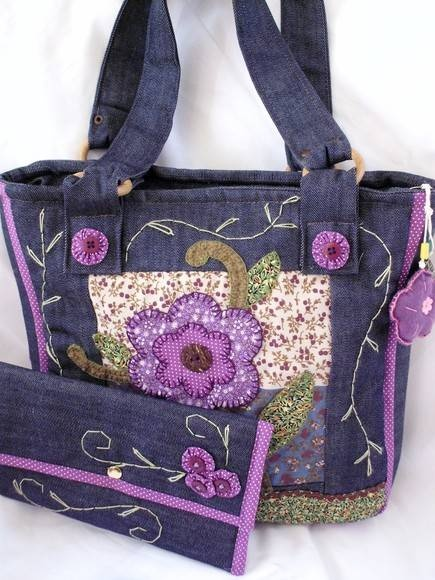 Violet embroidery and applique on what looks like dark denim