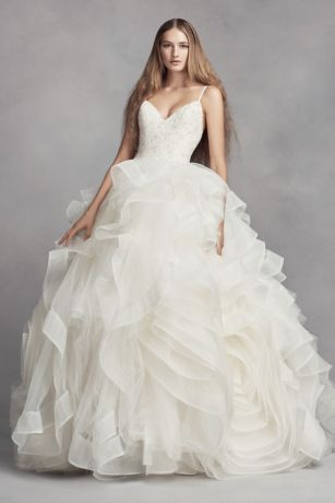 More than 100 yards of tulle, combined with cascading horsehair trim, give the skirt of this White by Vera Wang ball gown its frothy volume. The crystal-encrusted bodice of this ballet-inspired wedding dress is structured for support, and two rosettes are designed into the skirt, adding movement and interest.  White by Vera Wang, exclusively at David's Bridal  Polyester  Chapel train  Back zipper; fully lined  Dry clean  Imported  Also available in petite and extra length