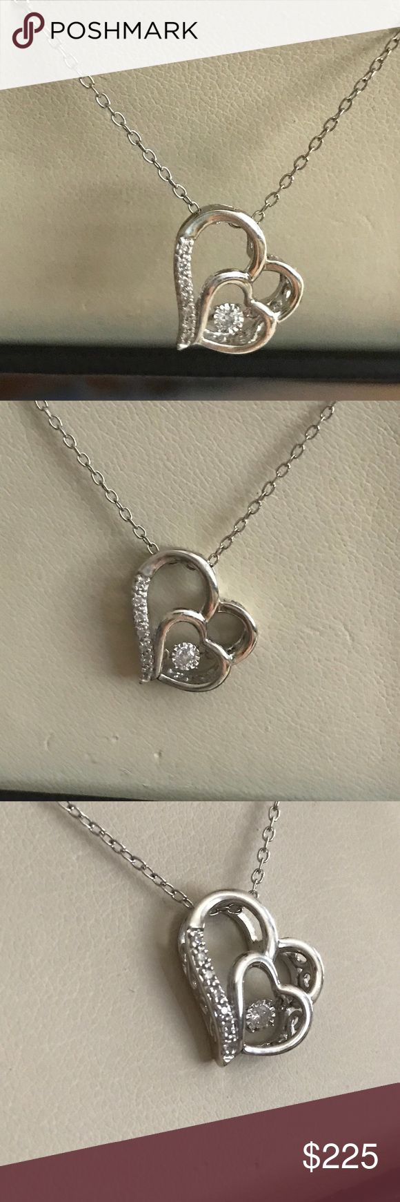 Diamond Rhythm Of Love Double Heart Necklace Beautiful genuine diamond rhythm double heart necklace. There is a diamond in the center as well as diamonds on the outer end of the large heart. It is set in sterling silver. It is hallmark 925 Zei ZEI Jewelry Necklaces