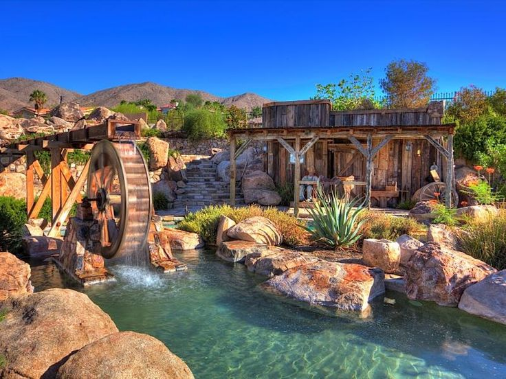 Why not go with an old west theme - this pool fits right in with it's water wheel and landscaping