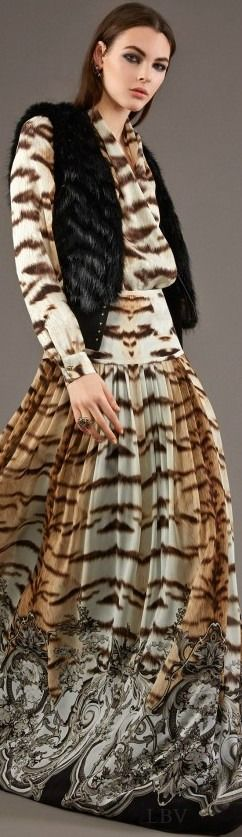 Roberto Cavalli ♥✤ Pre-Fall 2015  Plunging V-neck in tiger stripes looks very luxe boho inspired styled with black fur vest