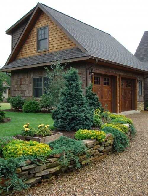 I like the brown pebble stone the dwarf trees on the raised lawn! The stacked stone separates it all too well.