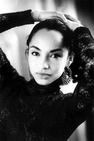 "Beauty Icon: Sade    Born in 1959 to a Nigerian father and an English mother, Sade spent the first four years of her life in Ibadan, Nigeria, before her mother, a nurse, moved her and her brother to England. Her full name, Helen Folasade Adu (meaning ""honor earns a crown""), was likely more exotic than any other in Clacton-on-Sea, the small town on the English coast where she grew up.    Photo: Chris Robert"