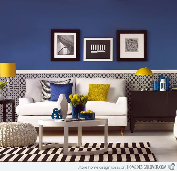 Dark walls with popping color accents (pillow, lamps).  (link: 15 living rooms)