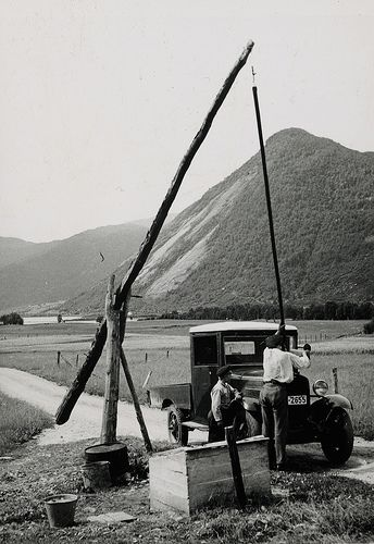 Elisabeth Meyer Two men loading up a truck. Landscape in the background. Photographs from Setesdal around 1940-42. Gelatin silver print, baryta