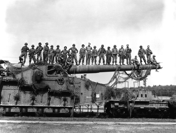 Allied WWII soldiers standing on a captured Schwerer Gustav railway siege gun. [1134x854]