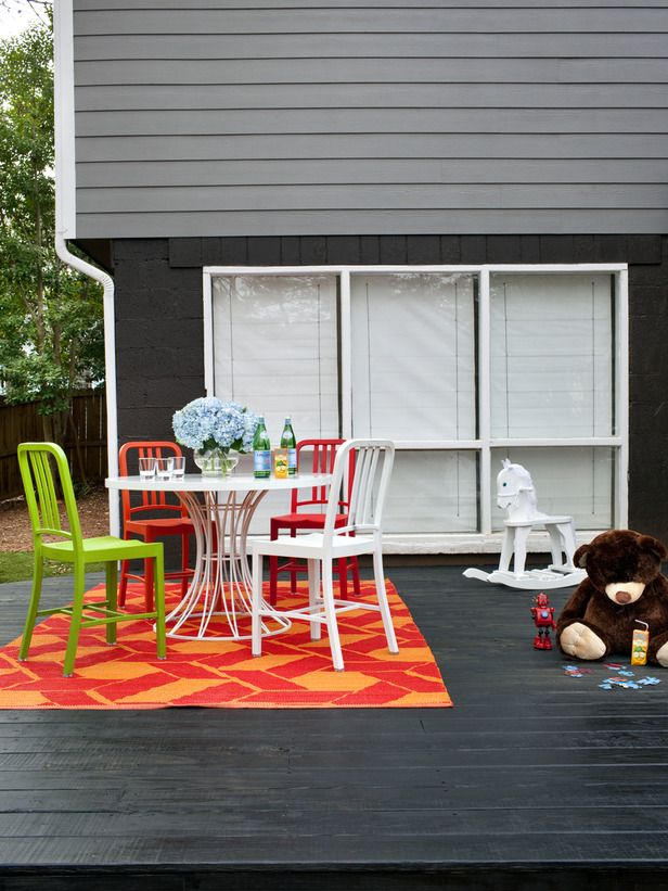 Layers of grey mixed with saturated colors bring life to this contemporary home.Decks Stained, Wooden Decks, Decks Patios, Backyards Ideas, Patios Ideas, Outdoor Spaces, Stained Decks, Gardens Backyards, Bright Colors