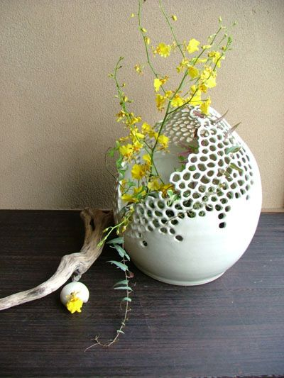 ceramic white vase how lovely - like honeycomb. Could try this in glass? Would just be a lot of sand blasting