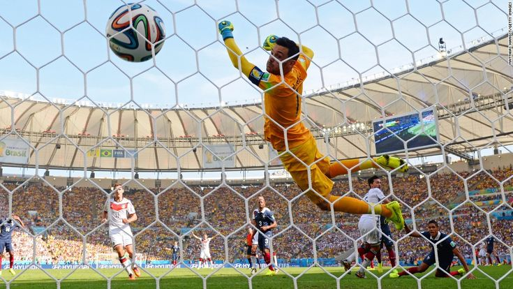 The ball flies by French goalkeeper Hugo Lloris after a header by Germany's Mats Hummels opened the scoring in their World Cup quarterfinal ...